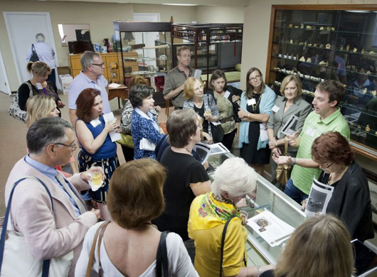 David Quinn, president of Quinn's Auction Galleries (far right), discusses the Helen and Jack Mang Collection of Japanese Netsuke with 2012 ISA FAE symposium participants. The Netsuke collection was auctioned in a high-profile sale held at Quinn's on December 7, 2012. Image courtesy of Quinn's Auction Galleries.