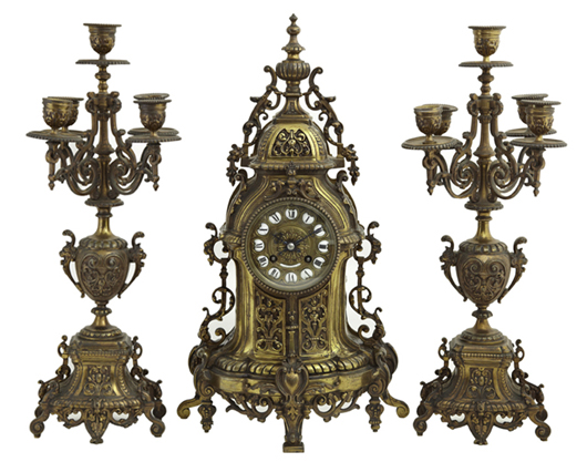 Three-piece Louis XV-style bronze clock set, with face and movement marked Tiffany & Co., est. $900-$1,500. Crescent City Auction Gallery image.