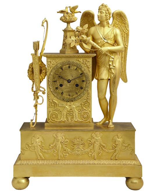 French Empire gilt bronze mantel clock, made circa 1820 by Hunziker of Paris, est. $1,500-$2,500. Crescent City Auction Gallery image.