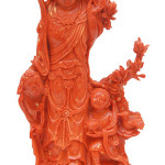 Large and heavy solid red coral sculpture depicting a maiden with children, 10 1/4 in tall. Elite Decorative Arts image.