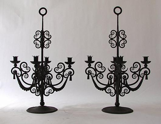 Lot 2: Alessandro Mazzucotelli, two wrought iron candleholders, signed 'AM' in the iron, Milano, 1925. Estimate: €5,000-6,000, starting bid: €2,000. Courtesy Nova Ars Asti.