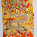 Imperial yellow embroidery, China, embroidered with five-clawed dragons among clouds and waves, 92 inches x 44 inches. Price realized: $11,000. Kaminski image.