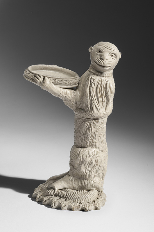 Monkey Bearing a Dish (Sand Holder from a Writing Set), c. 1750. Artist/maker unknown, German. Salt-glazed stoneware, 6 5/8 × 4 × 3 9/16 inches (16.8 × 10.2 × 9 cm). Promised gift of Charles W. Nichols.