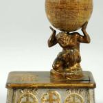 Atlas cast-iron mechanical bank, $12,000. Morphy Auctions image.