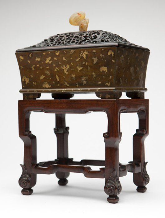 Dating to the 17th-18th centuries, this gilt-splashed bronze incense burner sent bidders into a frenzy, selling for $54,000 (estimate: $3,000-$5,000). John Moran Auctioneers image.