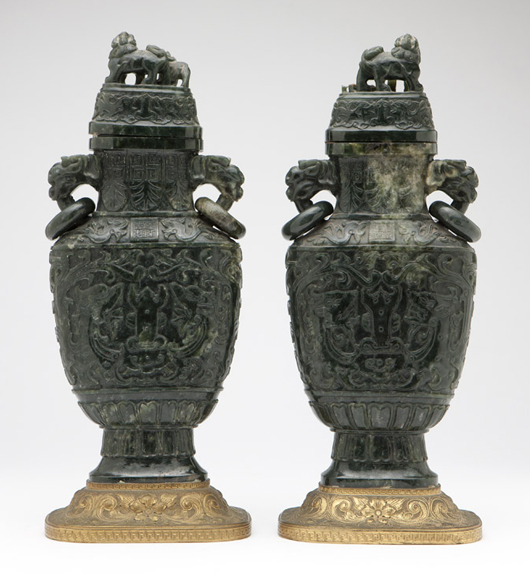 A pair of carved spinach jade covered urns on gilt metal bases, marked with a Qianlong chop mark, earned a $12,3000 sale price, well over the estimated $1,000-$1,500. John Moran Auctioneers image.