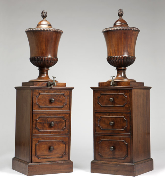 These George III walnut dining room urns are a furniture type described in George Hepplewhite's late 18th century treatise 'The Cabinet-Maker and Upholsterer's Guide.' The pair found a new home for $21,600 (estimate: $2,500-$3,500). John Moran Auctioneers image.