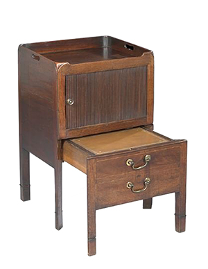 This George III mahogany piece is a commode, not a table. It was made in the 18th century to hold the necessary nighttime 'toilet' equipment behind tambour doors. It sold for $950 at a New Orleans Auction Galleries sale in October 2012.