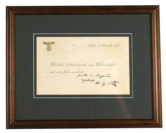Christmas greeting card from 1937 signed by Adolf Hitler, with embossed eagle/swastika. Price realized: $2,473. Mohawk Arms Inc. image.