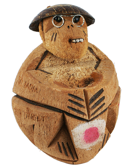 Coconut carved into a caricature of a Japanese soldier by a U.S. Marine on Okinawa in World War II. Price realized: $705. Mohawk Arms Inc. image.