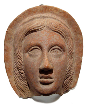 Etruscan terracotta relief of a facing female head, circa fourth-second century B.C. Ancient Resource LLC image.