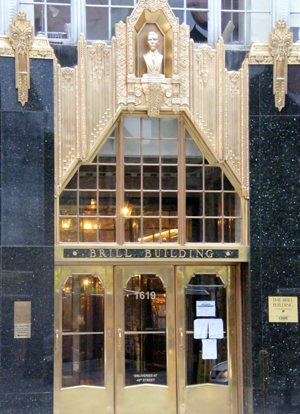 The entrance to the 1931 Brill Building, located at 1619 Broadway at 49th Street in Manhattan. Image by Americasroof at en.wikipedia. This file is licensed under the Creative Commons Attribution-Share Alike 3.0 Unported license.