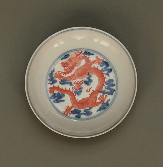 Chinese blue and white antique underglaze red dragon dish. Archive Auctions image.