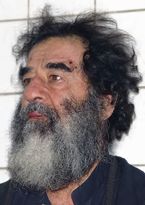 Saddam Hussein in a photo taken shortly after his capture. U.S. Military/Dept. of Defense photo, December 14, 2003.