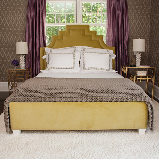 Custom upholstered queen-size bed in honeydew velvet designed by Barbara Page, opening bid $1,750. Photo by William A. Boyd Jr.