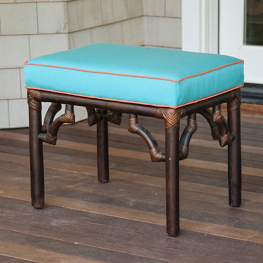 Faux bamboo ottoman upholstered in turquoise canvas with melon piping, chosen by designer Ken Gemes, opening bid $400. Photo by William A. Boyd Jr.