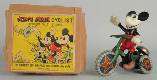 Celluloid Walt Disney Mickey Mouse on tin cycle, offered with rare original box with George Borgfeldt sticker, estimate $1,200-$1,600. Morphy Auctions image.