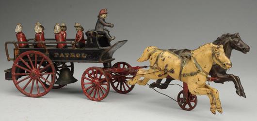 Ives cast-iron Phoenix horse-drawn fire patril, 20½in long, original driver and six original firemen figures. Estimate $2,000-$4,000. Morphy Auctions image.
