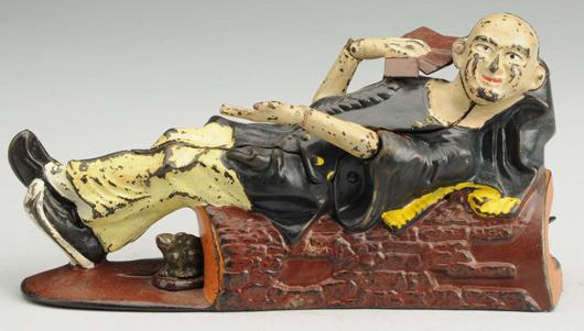 J. & E. Stevens Reclining Chinaman cast-iron mechanical bank, yellow-pants variation, estimate $3,000-$5,000. Morphy Auctions image.