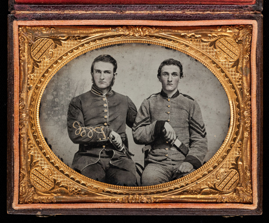 'Photography and the American Civil War,' a landmark exhibition organized by the Metropolitan Museum of Art, will travel to Charleston, S.C., and New Orleans. In this quarter-plate ambrotype with applied color, an unknown artist has photographed Capt. Charles A. and Sgt. John M. Hawkins of the Georgia Volunteer Infantry, 1861-1862. David Wynn Vaughan Collection; photo Jack Melton. Courtesy the Metropolitan Museum of Art.