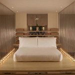 The raised-platform bed and Hollywood lights in this bedroom at the Hempel Hotel would bring out the rock star in anyone.