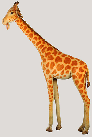 Steiff studio giraffe, early 1980s, 8ft tall, purchased at Wanamaker's in Philadelphia, retains Steiff button and tag, est. $4,000-$6,000. Morphy Auctions image.