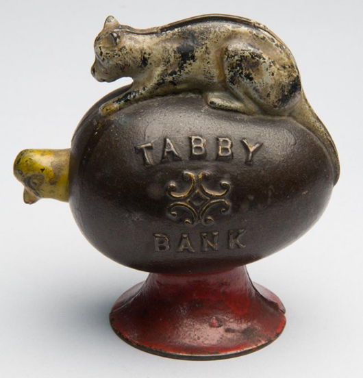 Tabby cast-iron mechanical bank, embossed 'Tabby Bank' with nodding chick, original paint, by J. & E. Stevens & Co., fourth quarter 19th century, 4 1/2 inches high. Price realized: $5,750 against $300-$500 estimate. Jeffrey S. Evans & Associates image.