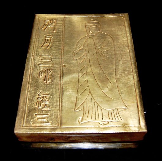 Gilt copper album of the 'Pratyutpanna Sutra' (Vol. 3) (Composing of the Mind), stitched and held together with hinges, complete with carved storage box. Gianguan Auctions image.