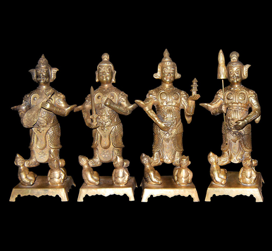 Gilt statues of Four Heavenly Kings, Stepping on Evils of Human Nature. Tang Dynasty, incised mark of Zhenguan and of the Period. Gianguan Auctions image.