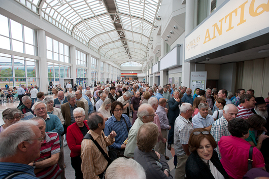 The crowds awaiting the opening of the recent Antiques For Everyone Fair at the National Exhibition Centre in Birmingham were significantly swelled by overseas buyers, according to Clarion Events, the fair's organizers. Image courtesy of Clarion Events and the NEC.