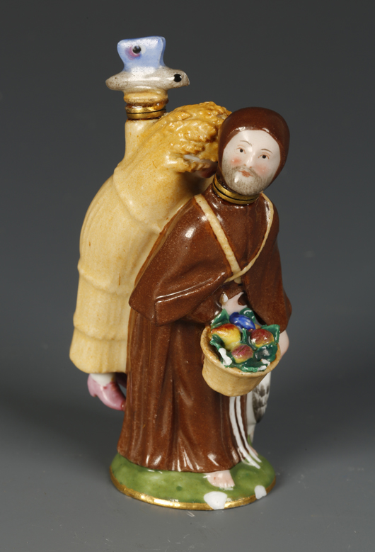 A curious Meissen porcelain scent flask in the form of a monk with a woman hiding in a wheat sheaf on his back, which made £700 ($1,080) at Duke's in Dorchester in August. Image courtesy of Duke's.