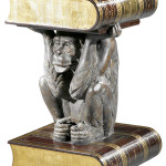 A live monkey in the living room would be a shock, but this monkey is bronze. He is holding a leather-bound book that serves as a tabletop. The whimsical table sold for $1,342 at Neal Auction Co. in New Orleans in July.