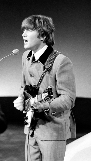 John Lennon performing with the Beatles in 1964. Image by VARA. This file is licensed under the Creative Commons Attribution-Share Alike 3.0 Netherlands license.