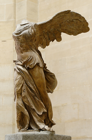 Circa-190 B.C. (?) parian marble sculpture known as 'La Victoire de Samothrace' or 'Winged Nike of Samothrace.' Discovered in the Greek island of Samothrace in 1863. From the Louvre Collection. 2007 photo by Marie-Lan Nguyen.