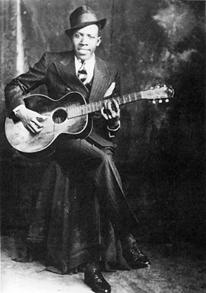 The 'studio portrait' of legendary bluesman Robert Johnson was taken around 1935 in Hooks Brothers Studio in Memphis. Copyright 1989 Delta Haze Corporation. Fair use of low-resolution copyrighted image under terms of US Copright Law. No other copyright-free image of the subject is believed to exist.