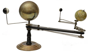 Vintage orrery by Trippensee Planetarium Co., Detroit, a mechanical device showing the relative position during the calendar year of the earth, moon and sun. Austin Auction Gallery image.