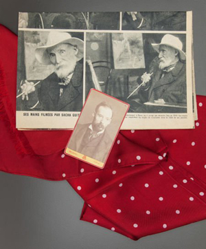 One of the unique items being sold is Renoir's silk scarf, 50 by 16 1/2 inches, accompanied by a photograph and newspaper article that show the artist wearing it. Image courtesy Heritage Auctions.