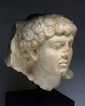 Limestone relief head of a young man, possibly a nobleman, Palmyra, Roman Period, circa 2nd-3rd century. Estimate $20,000-$25,000. Antiquities Saleroom image.