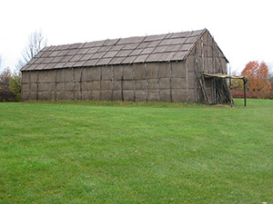 Reconstructed Seneca long house at the Ganondagan State Historic Site. Image by Dmadeo. This file is licensed under the Creative Commons Attribution-Share Alike 3.0 Unported, 2.5 Generic, 2.0 Generic and 1.0 Generic license.
