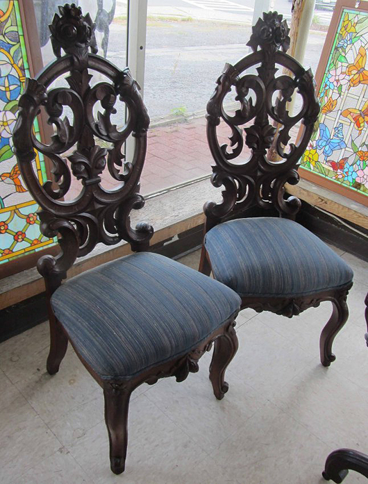 J.H. Belter had a factory in Manhattan populated with young immigrant German woodworkers. Did he or they make these two chairs? Without a label they were sold as 'belter quality' but without a positive attribution. Image courtesy of LiveAuctioneers.com Archive and Great American Auction Services.
