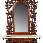 Heavily carved Mitchell & Rammelsberg walnut marble-top hall tree with mirror, 101 inches tall. Estimate: $15,000-$25,000. Fontaine's Auction Gallery image.