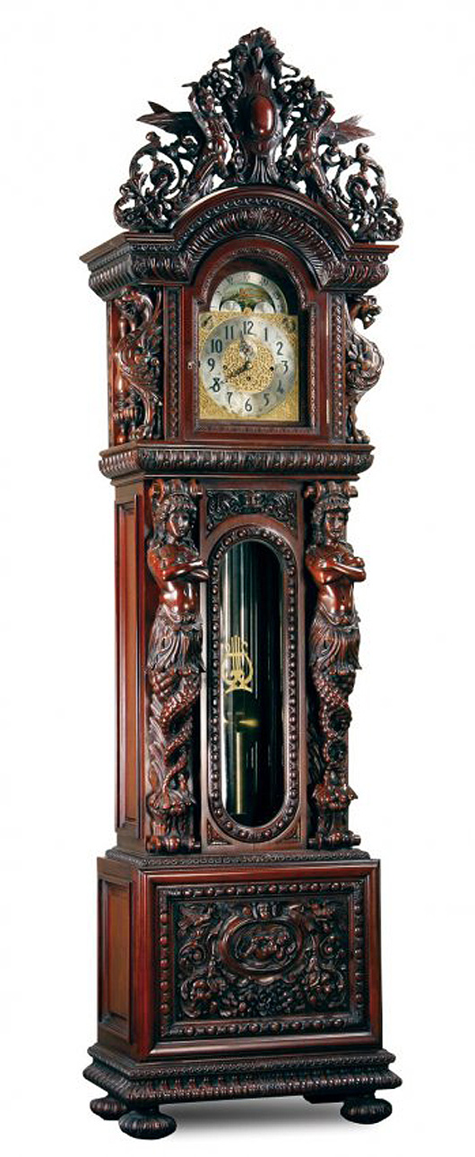 One of the great cabinetmakers around the turn of the 20th century was R. Horner of New York. Did he make this clock case? The winged griffins look like his. The formed maiden supports look like his. The overall style of the carving looks like his. But he did not sign it so it is 'attributed' to his shop. Image courtesy of LiveAuctioneers.com Archive and Great Gatsby's.