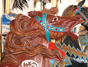 Closeup of horse's head on an antique Herschell-Spillman Noah's Ark carousel at the Oaks Amusement Park in Portland, Oregon. Herschell-Spillman carousel animals are revered for their beautiful carving and details. Photo by Werewombat, licensed under the Creative Commons Attribution-Share Alike 3.0 Unported license.