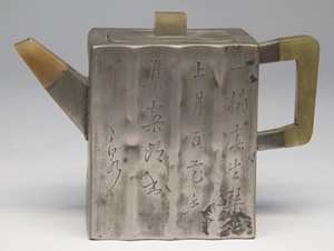 Chinese red pottery pewter-clad teapot and cover with jade handle, spout and finial to cover, 4 3/4 inches high, 1790-1840, sold for $3,450. Jeffrey S. Evans & Associates image