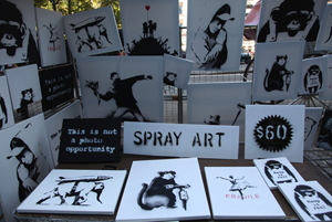 Banksy posted this picture online of the pop-up art stall in Central Park where his original, signed spray paintings were offered for $60 apiece.