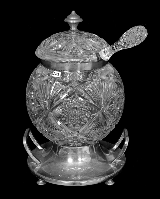 American brilliant cut glass covered wassail bowl with hobstar and fan motif, 18 1/2 inches by 11 1/2 inches. Woody Auction image.
