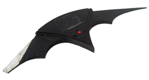 From Tim Burton's 'Batman Returns' (1992), a hero screen-used 'batarang' used by Danny DeVito (as the Penguin), to attack the Ice Princess (Cristi Conaway) in her dressing room before the Gotham City Christmas tree lighting ceremony in his attempt to frame Batman. Premiere Props image.