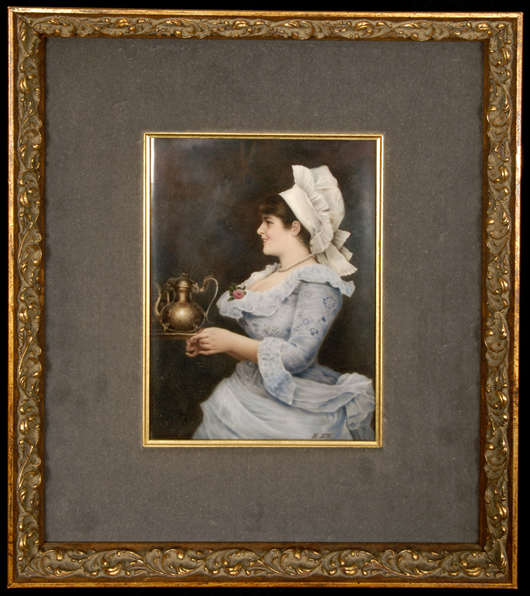 Marked KPM porcelain plaque showing a beautiful portrait of the 'Chocolatier,' 9 inches by 6 1/2 inches (minus frame). Woody Auction image.