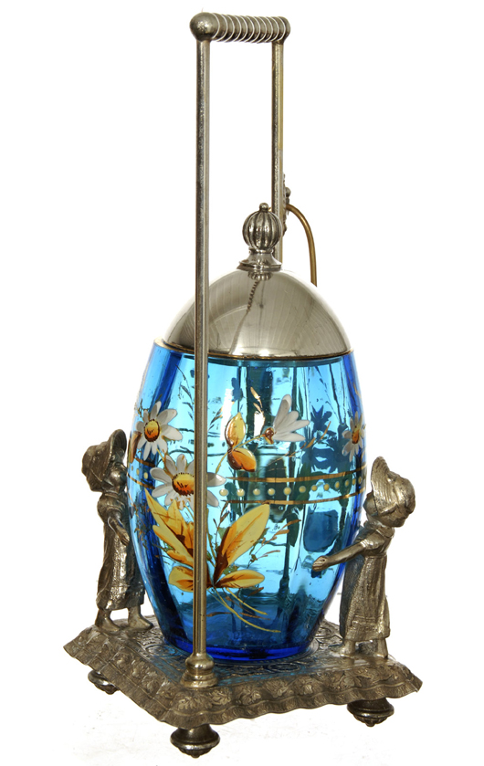 Ten-inch pickle caster having a blue art glass egg-shaped insert with enamel floral décor, on a Tufts silver-plated frame. Woody Auction image.
