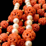 Collection of two carved coral bead, cultured pearl, 14K gold necklaces. Sold for: $16,520. Michaan's Auctions image.
